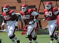 NWA Democrat-Gazette/ANDY SHUPE<br /> Arkansas offensive lineman Johnny Gibson (62) runs Tuesday, Aug. 11, 2015, during practice at the university's practice field in Fayetteville.