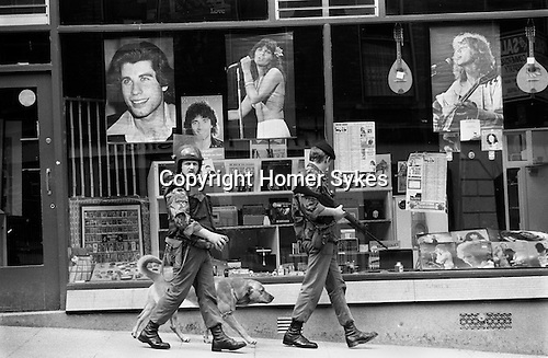 Derry Northern Ireland Londonderry. 1979. British soldiers on patrol with sniffer dog.