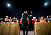 26 April 2008 - Washington, D.C. - President George W. Bush conducts the Marine Corps Band during the White House Correspondents Association Dinner. Photo Credit: Kristoffer Tripplaar/ Sipa Press