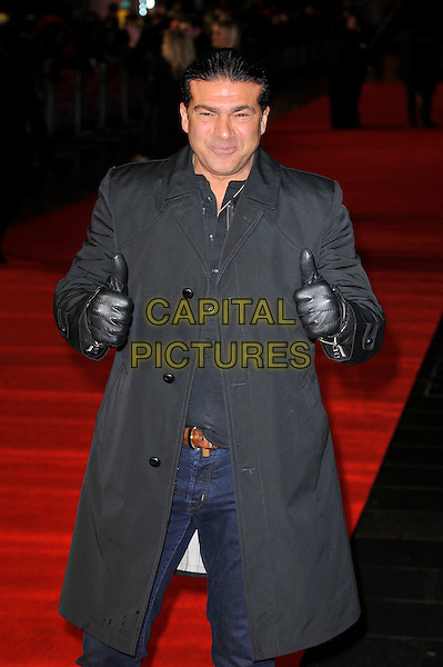 "Tamer Hassan.The ""Run For Your Wife"" world film premiere, Odeon Leicester Square cinema, Leicester Square, London, England..February 5th, 2013.half length black gloves grey gray coat hands arms thumbs up.CAP/MAR.© Martin Harris/Capital Pictures."