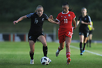Paige Satchell of New Zealand Women's battles with Natasha Harding of Wales Women's' during the Women's International Friendly match between Wales and New Zealand at the Cardiff International Sports Stadium in Cardiff, Wales, UK. Tuesday 04 June, 2019