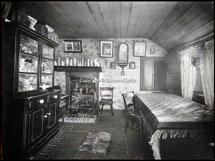 BNPS.co.uk (01202 558833)<br /> Pic: GibsonOfScilly/BNPS<br /> <br /> Cornish kitchen in west Penwith<br /> <br /> An archive of eye-opening photographs documenting the grim reality of Poldark's Cornwall has emerged for sale for £25,000.<br /> <br /> More than 1,500 black and white images show the gritty lives lived by poverty-stricken families in late 19th and early 20th century Cornwall - around the same time that Winston Graham's famous Poldark novels were set.<br /> <br /> The collection reveals the lowly beginnings of towns like Rock, Fowey, Newquay and St Ives long before they became picture-postcard tourist hotspots.<br /> <br /> Images show young filth-covered children playing barefoot in squalid streets, impoverished families standing around outside the local tax office, and weather-beaten fishwives tending to the day's catch.<br /> <br /> The Cornish archive, comprising 1,200 original photographic prints and 300 glass negative plates, is tipped to fetch £25,000 when it goes under the hammer as one lot at Penzance Auction House.