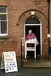 Mary Mallatratt Hot Cross Bun Legacy. Good Friday annually Mansfield Nottinghamshire. Mrs Ann Binch pushing a trolly with 48 Hot Cross Buns which will be distributed in the local shoppimg centre.