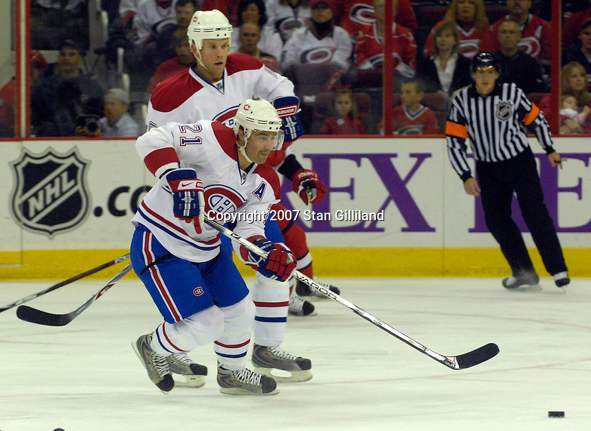 Montreal Canadiens' Christopher Higgins (21) passes up ice against the Carolina Hurricanes Friday, Oct. 26, 2007 in Raleigh, NC. The Canadiens won 7-4.