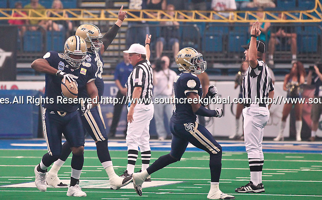 Aug 14, 2010: The Tampa Bay Storm celebrate a touchdown. The Storm defeated the Predators 63-62 to win the division title at the St. Petersburg Times Forum in Tampa, Florida. (Mandatory Credit:  Margaret Bowles)