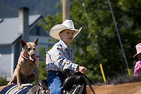 Boy & his Dog horseback in Chief Joseph Day Parade,Joseph,Oregon