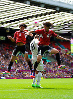 29.07.2012 Manchester, England. Egypt defender Mahmoud Alaa El-Din, Egypt defender Ahmed Hegazy beat New Zealand forward Chris Wood to the high ball during the first round group C mens match between Egypt and New Zealand.