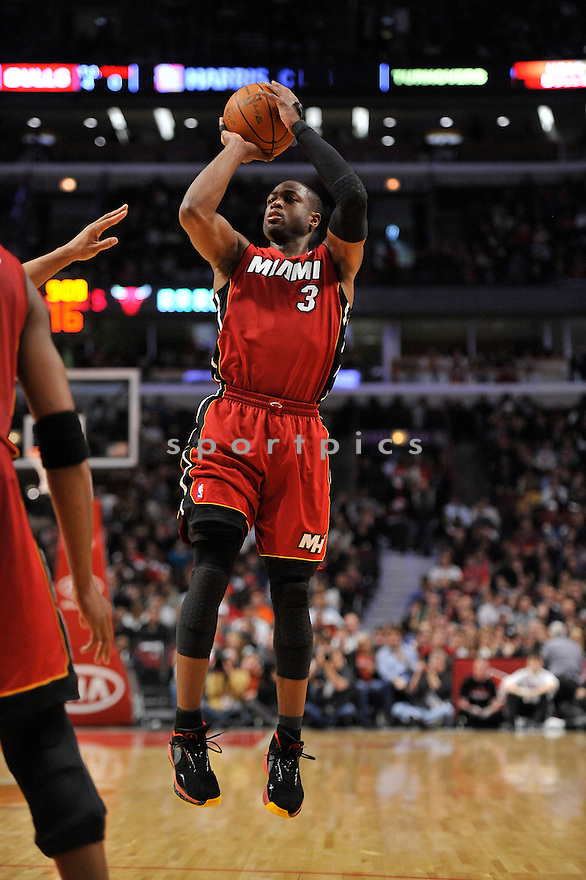 DWAYNE WADE, of the Miami Heat , in actions during the Heat game against the Chicago Bulls at the United Center on January 15, 2011.  The Bulls won the game beating the Heat 99-96