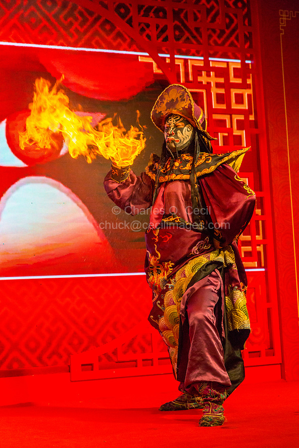 Wenzhou, Zhejiang, China.  Chinese Opera Performer and Face Changing Demonstration.  Fire Emphasizes the Anger of the Character.