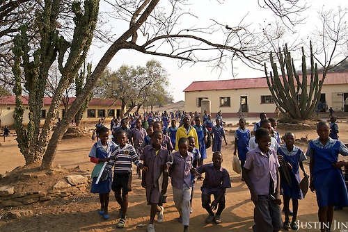Children at the Mutenda Primary School in drought-hit Masvingo Province, Zimbabwe.  <br /> <br /> Drought in southern Africa is devastating communities in Zimbabwe, leaving 4 million people urgently in need of food aid. The government declared a state of emergency,. <br /> <br /> Here in Masvingo Province, the country's hardest hit province, vegetation has wilted, livestock is dying, and people are at serious risk of famine. <br /> <br /> Pictures shot by Justin Jin