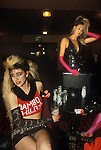 Sigue Sigue Sputnik. Punk band 1980s. Back stage crew. Newcastle Upon Tyne. UK.<br /> Magenta Devine was promoter for band seen here in short skirt lived with lead singer Tony James.