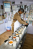 Rajah Banerjee, the owner of Makaibari Tea Estate, tastes various types of teas at the Makaibari Tea estate, in Darjeeling, India