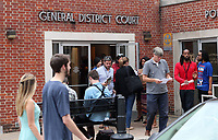 Reporters exit the Charlottesville District Court after the arraignment of James Alex Fields Jr., 20, of Maumee, Ohio Monday in Charlottesville, Va. Fields Jr. was charged with one count of second-degree murder, three counts of malicious wounding and one count of hit and run with injury after plowing through a crowd of counter protestors on Saturday. Photo/Andrew Shurtleff