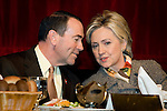 Then Arkansas Governor Mike Huckabee chats with Senator Hillary Clinton during the First Ladies of Arkansas Luncheon as part of the William Jefferson Clinton Presidential Library dedication Wednesday, Nov 17, 2004 in Little Rock, Arkansas.
