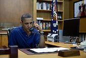 United States President Barack Obama holds a conference call from Camp David during a briefing on the tragedy in Afghanistan with U.S. Secretary of Defense Leon Panetta, Admiral Mike Mullen, Chairman of the Joint Chiefs of Staff, National Security Advisor Tom Donilon and Chief of Staff Bill Daley, Saturday, August 6, 2001..Mandatory Credit: Pete Souza - White House via CNP