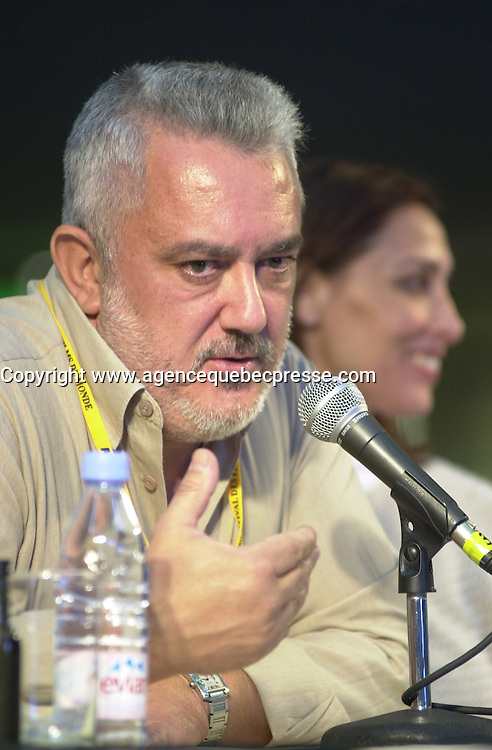 Aug 23,  2002, Montreal, Quebec, Canada<br /> <br /> Imanol Uribe, in a press conference about his movie<br /> EL VIAJE DE CAROL (Carol's Journey / Le Voyage de Carol), presented in the official competition of the 26th World Film Festival<br /> <br /> Born in El Salvador to Spanish parents in 1951, Imanol Uribe has lived and worked in Spain since 1957. After graduating in journalism he studied cinema and began directing short and medium-length films. He made his directorial debut in 1979 with EL PROCESO DE BURGOS. His filmography includes: LA FUGA DE SEGOVIA (1981), LA MUERTE DE MIKEL (1983), ADIOS PEQUE&mdash;A (1986), THE DUMBFOUNDED KING (1991), RUNNING OUT OF TIME (1994), BWANA (1995), EXTRA&mdash;OS (1998) and PLENILUNIO (2001),<br /> <br /> Mandatory Credit: Photo by Pierre Roussel- Images Distribution. (&copy;) Copyright 2002 by Pierre Roussel <br /> <br /> NOTE : <br />  Nikon D-1 jpeg opened with Qimage icc profile, saved in Adobe 1998 RGB<br /> .Uncompressed  Uncropped  Original  size  file availble on request.