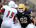 SIOUX FALLS, SD - SEPTEMBER 7:  Jamal Samaha #92 from Augustana closes in for a sack on Demetrius Carr #15 from Minnesota State University Moorhead in the first quarter of their game Saturday at Augustana. (Photo by Dave Eggen/Inertia)