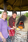 PIZZA: John Walker Pizia maker and Rachel Budd of the Shanakill/Rahoonane Organic Garden Centre taken out their first cook Pizza from their home made Pizia Oven, on Saturday.........................