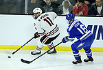 SIOUX FALLS, SD - MARCH 23: Ryan Poehling #11 from St. Cloud State University controls the puck in front of Kyle Haak #16 from Air Force during their game at the 2018 West Region Men's NCAA DI Hockey Tournament at the Denny Sanford Premier Center in Sioux Falls, SD. (Photo by Dave Eggen/Inertia)