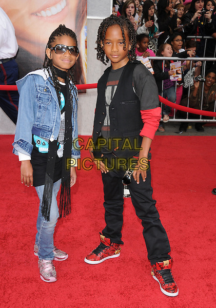"WILLOW SMITH & JADEN SMITH.""The Hannah Montana Movie"" Los Angeles Premiere held at the El Capitan Theatre, Hollywood, California, USA. .April 2nd, 2009.full length black scarf sunglasses shades black waistcoat jeans pink trainers .CAP/DVS.©Debbie VanStory/Capital Pictures."
