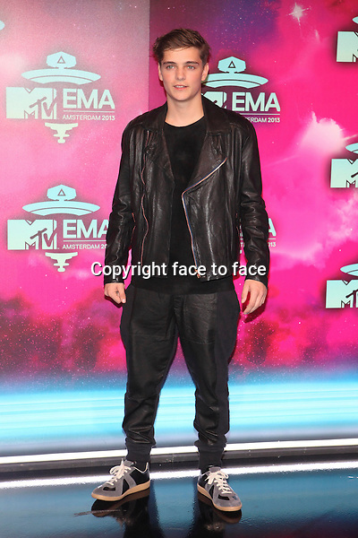 AMSTERDAM - Martin Garrix at the MTV Europe Music Awards 2013 at the Ziggodome in Amsterdam.<br />