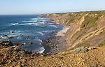 Rocky rugged coastal landscape on the Rota Vicentina Fisherman's Trail long distance footpath route, near Bunheira, Aljezur, Algarve, Portugal, Southern Europe