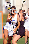 Torrance, CA 05/09/13 - Kelsie Garrison (Agoura #23) and Jennifer Maholchic (Oak Park #9) in action during the 2013 Los Angeles area Girls Varsity Lacrosse Championship.  Agoura defeated Oak Park 13-7.