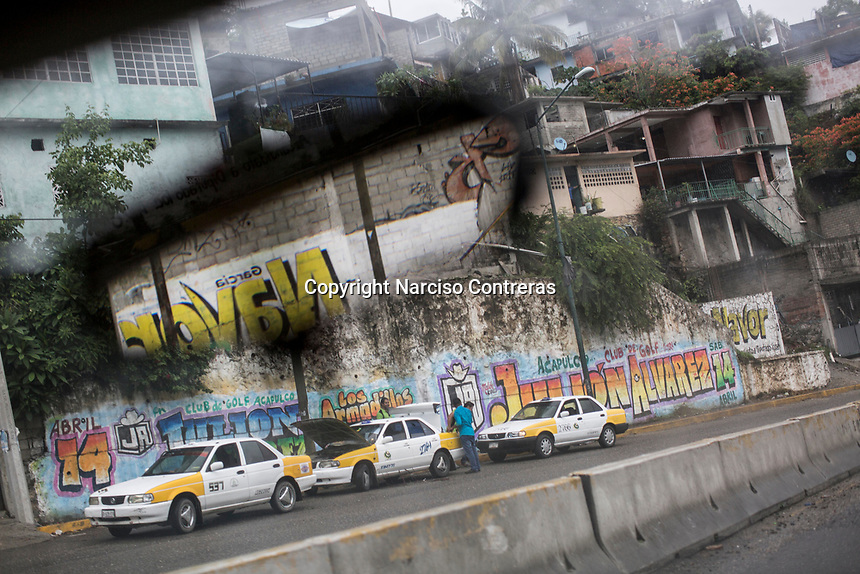 "June 16, 2018: A taxi service station in Cuauhtémoc Avenue at ""La Garita"", a violence-plagued neighbourhood in Acapulco, Guerrero. Taxi drivers are forced to pay dues to organised crime, otherwise they are executed and thrown at taxi stations."