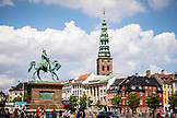 DENMARK, Copenhagen, Colorful buildings and statue in front of Nikolaj Kunsthal, Europe