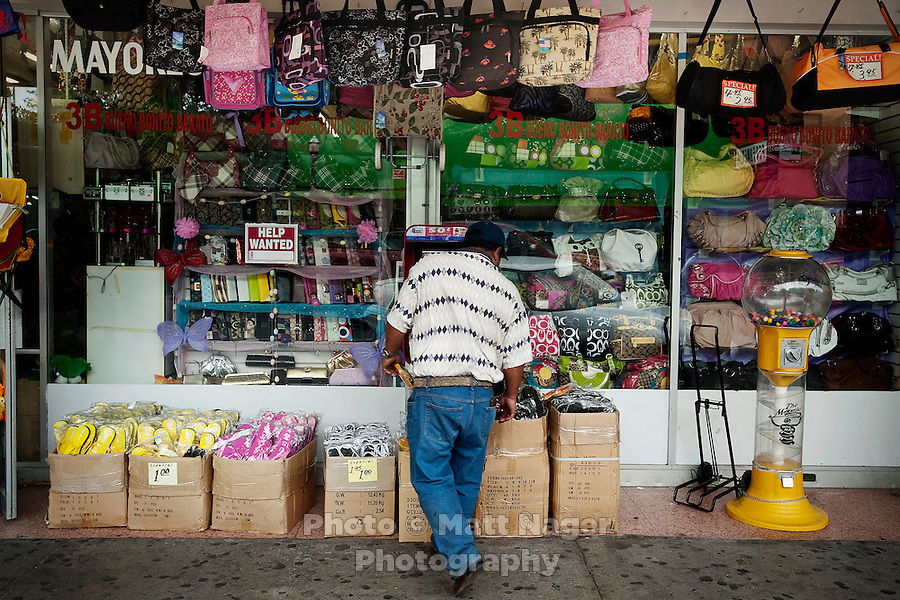 A shopper searches for sandals along Main Street in downtown McAllen, Texas, Sunday, April 4, 2010. Downtown McAllen stores don't sell designer or name brand items, but still reach a wide customer base for McAllen residents and visiting Mexican tourists. ..PHOTO/ Matt Nager