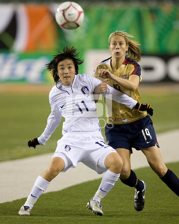 US Womens National Team defender Marian Dalmy battles for position with Korea Republic midfielder Hee Young Park during their game at Paul Brown Stadium in Cincinnati, Ohio on November 5, 2008.