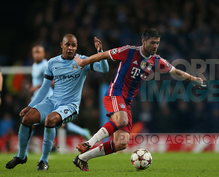 Fernando of Manchester City and Xabi Alonso of Bayern Munich  - UEFA Champions League group E - Manchester City vs Bayern Munich - Etihad Stadium - Manchester - England - 25rd November 2014  - Picture Simon Bellis/Sportimage