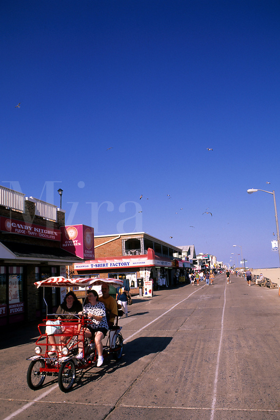 Famous Ocean City Maryland USA  famous Boardwalk on the beach trolley and shops.