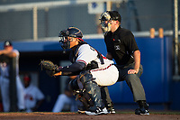 Danville Braves catcher William Contreras (24) sets a target as home plate umpire Brandon Blome looks on during the game against the Princeton Rays at American Legion Post 325 Field on June 25, 2017 in Danville, Virginia.  The Braves walked-off the Rays 7-6 in 11 innings.  (Brian Westerholt/Four Seam Images)