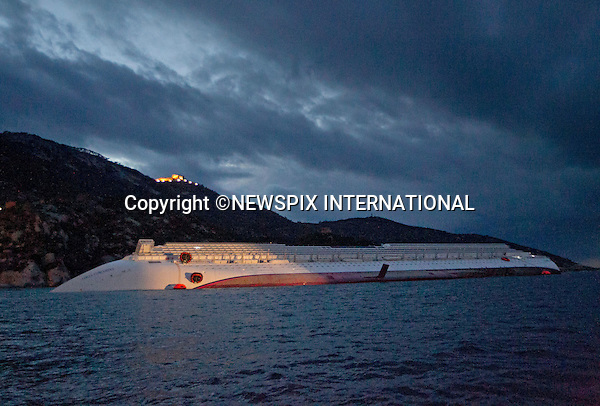 """EXCLUSIVE! : *** Telephone +441279 324672 FOR REPRODUCTION FEES ***.Isola di Giglio, Italy_16/01/2012:  COSTA CONCORDIA CRUISE TRAGEDY.The luxury cruise ship Costa Concordia, that ran aground near Isola del Giglio..The Costa Concordia which was carrying 4,200 people, experienced trouble a few hundred metres from the tiny Tuscan holiday island of Giglio on Friday evening as the passengers were at dinner, after apparently sailing off course..Mandatory Credit Photo: ©Sestini/NEWSPIX INTERNATIONAL..**ALL FEES PAYABLE TO: """"NEWSPIX INTERNATIONAL""""**..IMMEDIATE CONFIRMATION OF USAGE REQUIRED:.Newspix International, 31 Chinnery Hill, Bishop's Stortford, ENGLAND CM23 3PS.Tel:+441279 324672  ; Fax: +441279656877.Mobile:  07775681153.e-mail: info@newspixinternational.co.uk"""