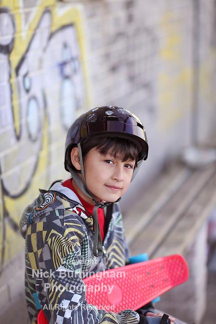 Boy with Skateboard Helmet in the Park