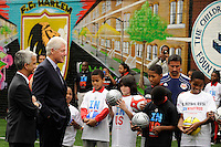 Former President Bill Clinton talks to some students prior to a press conference announcing former President Bill Clinton as the honorary chairman of the USA Bid Committee to host the FIFIA World Cup in 2018 or 2022 at the FC Harlem Field in Harlem, NY, on May 17, 2010.
