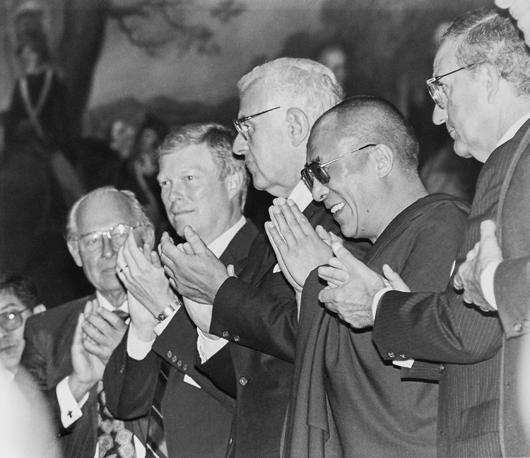 Dalai Lama receives warm welcome from the Members of Congress, Tibetans, and the Leaders. Rep. Robert H. Michel, R-Ill., Rep. Dick Gephardt, D-Mo., Rep. Mark Foley, R-Fla., Sen. George J. Mitchell, D-Maine., and Sen. Bob Dole applaud, on April 22, 1991. (Photo by Laura Patterson/CQ Roll Call via Getty Images)