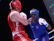 Fairfax, VA - July 1, 2015:  Berinder Singh (Blue) of the Indian Police Service sets for a punch in a boxing match against Abdussanat Sharafov (red) of the Kazakhstan Fire Department during the World Police and Fire Games at the George Mason University in Fairfax, VA, July 1, 2015.   (Photo by Don Baxter/Media Images International)