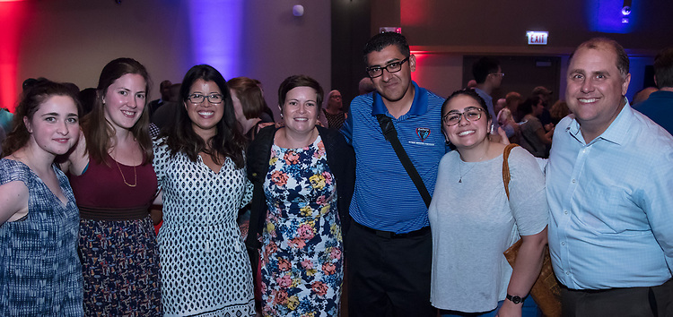 DePaul University faculty and staff share a smile at the annual University Picnic to celebrate the conclusion of the 2016-17 school year. (DePaul University/Jeff Carrion)
