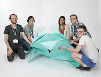 OrigamiUSA 2016 Convention at St. John's University, Queens, New York, USA. Oversized 9' x 9' paper folding event. First timers. Left to right: Robby Kraft, NY, Adrienne Sack, NY, Yuki Martin, OR, David Einheber, MN, Chad Killeen, MI.