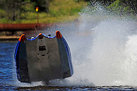 Frame 7: #42 rides up and over the roostertail of leader R.J. West, (#93) during the final heat.   (SST-45 class)
