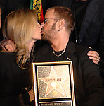 UK musician Ringo Starr kisses wife Barbara Bach as he was honored with the 2,401st Star on the Hollywood Walk of Fame in Los Angeles, California 08 February 2010. The former Beatle was joined by his wife Barbara Bach, Joe Walsh, Ben Harper and Don Was. This Monday evening ceremony also marked the 50th anniversary of groundbreaking on the sidewalk attraction..Photo by Nina Prommer/Milestone Photo