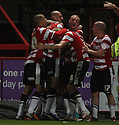 Rob Jones of Doncaster is mobbed by team-mates after scoring the winning goal. Stevenage v Doncaster Rovers - npower League 1 -  Lamex Stadium, Stevenage - 12th January, 2013. © Kevin Coleman 2013.