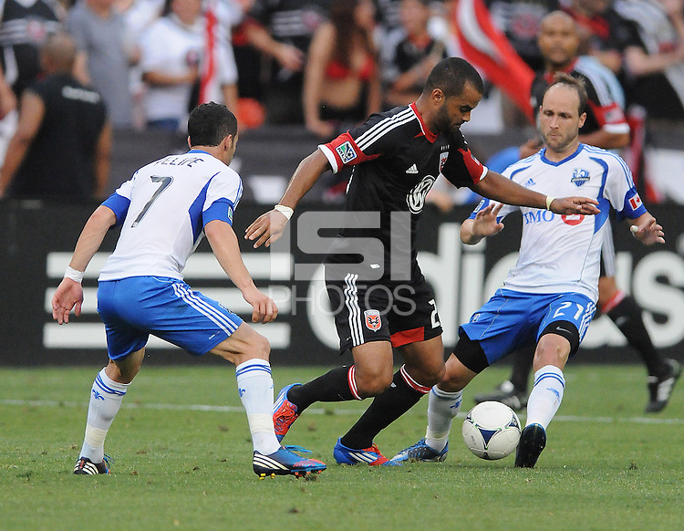 D.C. United forward Maicon Santos (29) goes against Montreal Impact midfielder Felipe Martins (7) and midfielder Justin Mapp (21) D.C. United defeated Montreal Impact 3-0 at RFK Stadium, Saturday June 30, 2012.