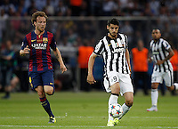 Calcio, finale di Champions League Juventus vs Barcellona all'Olympiastadion di Berlino, 6 giugno 2015.<br /> Juventus' Alvaro Morata, right, is chased by FC Barcelona's Ivan Rakitic during the Champions League football final between Juventus Turin and FC Barcelona, at Berlin's Olympiastadion, 6 June 2015. Barcelona won 3-1.<br /> UPDATE IMAGES PRESS/Isabella Bonotto