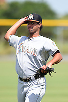 GCL Marlins pitcher Leurys De La Rosa (16) warms up during practice before a game against the GCL Nationals on June 28, 2014 at the Carl Barger Training Complex in Viera, Florida.  GCL Nationals defeated the GCL Marlins 5-0.  (Mike Janes/Four Seam Images)