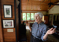 NWA Democrat-Gazette/ANDY SHUPE<br /> Joyce Hale of Fayetteville speaks Tuesday, May 7, 2019, near a photograph of a statue that she and her husband, Jay, own from when it once stood at the Diana Hotel in Springdale. The statue was purchased from the Diana Hotel in Springdale in the 1970s and now resides in the Hales' backyard.