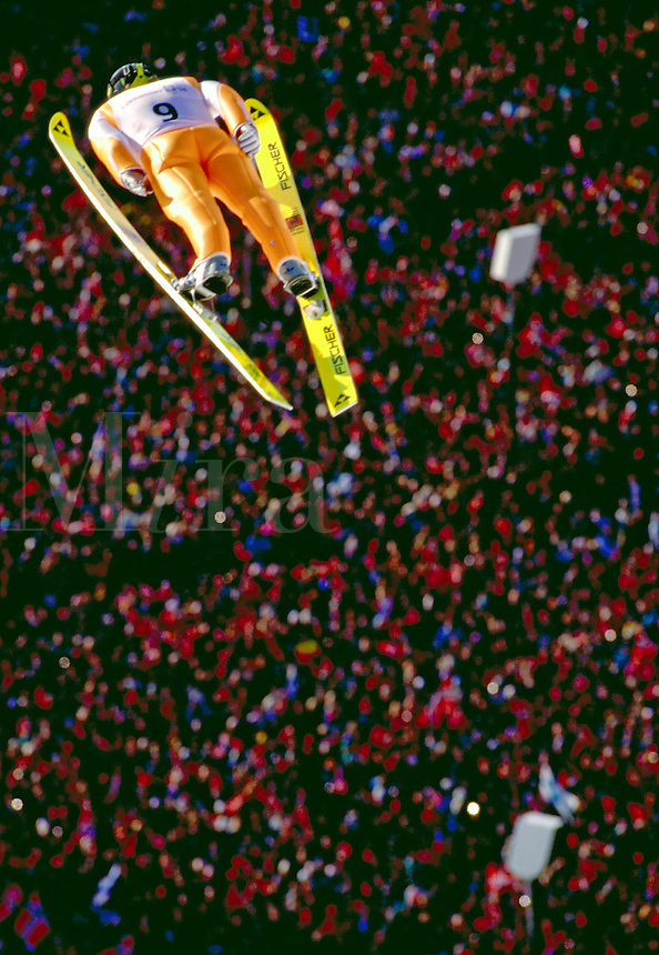 Ski jumper during competition at 1994 Winter Olympics. Lillehammer, Norway Olympic Ski Jump Arena.