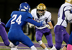 SIOUX FALLS, SD - OCTOBER 25: Sam Kruger #14 from Winner looks for an opening past Collin Reitsma #24 from Sioux Falls Christian in the first half of their 11B playoff game Thursday nigh at Bob Young Field in Sioux Falls.(Photo by Dave Eggen/Inertia)